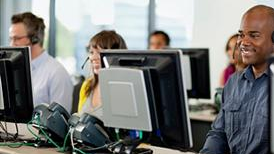Photo of people answering help line