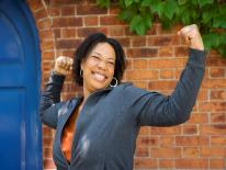 Woman with arms raised in triumph
